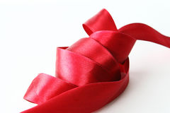 Red Ribbon. A roll of Red ribbon on white background royalty free stock image