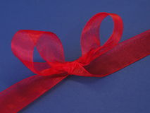 Red ribbon. Isolated on blue Royalty Free Stock Image