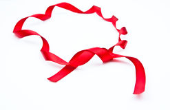 Red ribbon. Isolate over white background Royalty Free Stock Photography