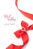 Red ribbon. Red gift ribbon bow with heart on white background Royalty Free Stock Photo