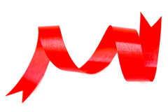 Red ribbon. Red and curly ribbon on white background Royalty Free Stock Photography