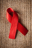 Red ribbon aids awareness Stock Image
