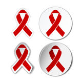 Red ribbon - AIDS awereness sign Stock Images