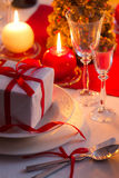 Red ribbon as an accent on Christmas table Royalty Free Stock Photography