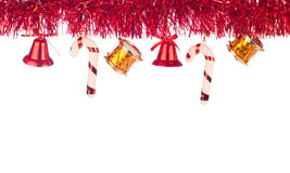 Red ribbon as xmas border. Nice red xmas border with bells, drums and lollipops royalty free stock photo