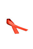 Red ribbon awareness on woman human hand aged white background: Stock Photos