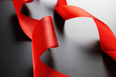 Red ribbon on black Royalty Free Stock Photos