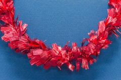 Red ribbon on blue paper for background Stock Photography