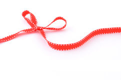 Red ribbon bow. Red ribbon in a bow with copy space for your text Stock Photography