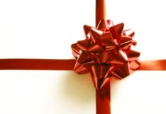 Red ribbon and bow. Of a present isolated on white stock images