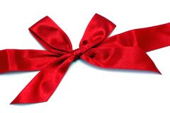 Red ribbon with bow. Isolated on white Stock Photo