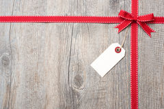 Red ribbon and bow with address label Royalty Free Stock Photography