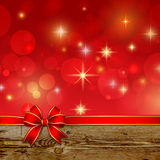 Red ribbon bow with bokeh Christmas decoration Royalty Free Stock Photos