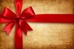Red ribbon and bow on the cartoon box Royalty Free Stock Images