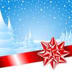 Red ribbon with bow with Christmas landscape Stock Photography