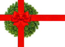 Red ribbon bow with christmas wreath isolated on white Royalty Free Stock Images