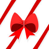 Red ribbon with bow diagonally on white background royalty free stock photo