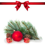 Red ribbon bow end bauble on white background. Christmas tree. Royalty Free Stock Photos