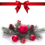 Red ribbon bow end bauble on white background. Christmas tree. Royalty Free Stock Photo