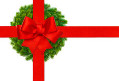 Red ribbon bow and green christmas wreath. Isolated on white background royalty free stock images