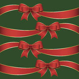 Red Ribbon Bow on Green Tile Background. Red and gold foil holiday ribbon with bows on green background Royalty Free Stock Photo