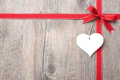 Red ribbon and bow with heart Stock Photo