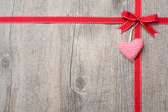 Red ribbon and bow with heart Royalty Free Stock Image