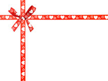 Red ribbon and bow with heart pattern Stock Photography