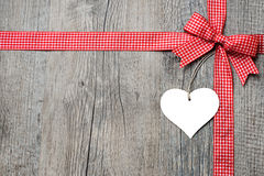 Red ribbon and bow with heart Stock Photos