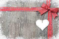 Red ribbon and bow with heart Royalty Free Stock Images