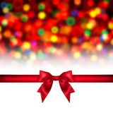 Red ribbon bow on holidays background. Royalty Free Stock Photos