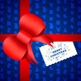 Red ribbon with bow, Isolated on blue pattern background Stock Photography