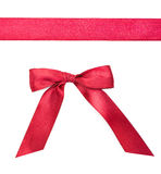 Red ribbon with a bow isolated on white. Background Stock Photo