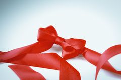 Red ribbon bow isolated on white background Stock Photos