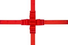 Red ribbon bow isolated on white. Holidays background Royalty Free Stock Image