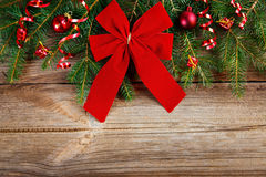 Red Ribbon Bow On Wooden Board Stock Images