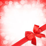 Red ribbon with bow over christmas snow background Stock Photo