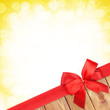 Red ribbon with bow over christmas snow background Stock Photography