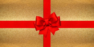 Red ribbon bow over shiny golden background. Gift card Royalty Free Stock Photos