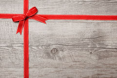 Red ribbon and bow over wooden background stock photos