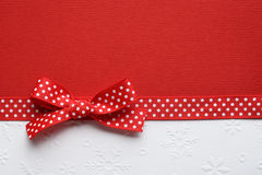 Red ribbon bow on paper Royalty Free Stock Photos