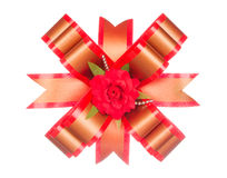 Red ribbon bow with red flower isolated on white Stock Images