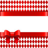 Red ribbon with bow on a rhombus background. Space for text. Stock Photo