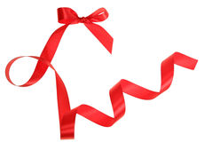 Red ribbon with bow. Red satin ribbon with bow isolated on white background Stock Photos