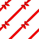 Red ribbon and bow seamless pattern background isolated on white. There is in addition a vector format EPS 8 Stock Photography