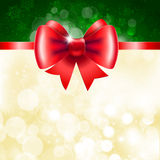 Red ribbon with bow on shining background. Royalty Free Stock Photo