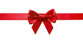 Red ribbon with bow with tails royalty free stock images