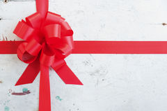 Red ribbon and bow on a vintage background Royalty Free Stock Photography