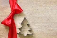 Red ribbon and bow on vintage cutting board christmas background Stock Images