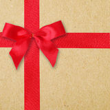 Red ribbon and bow on vintage paper. Background Stock Photo